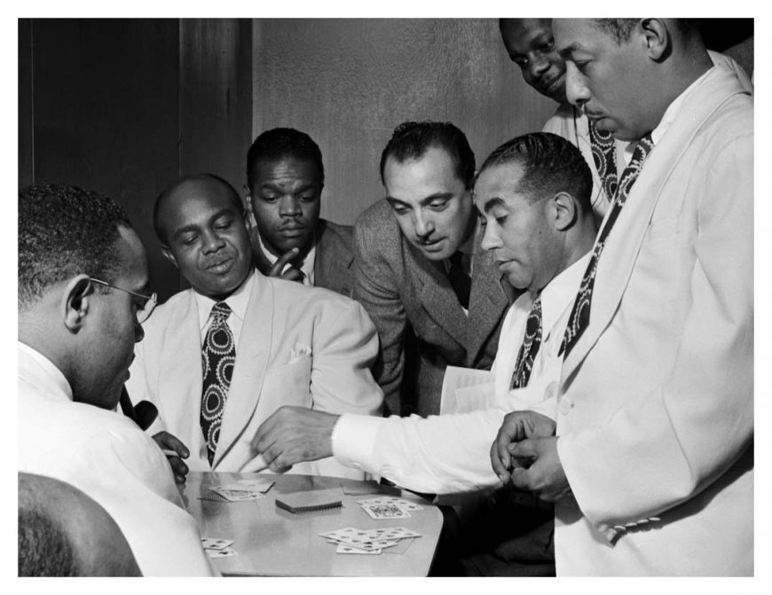poker-al-sears-shelton-hemphill-junior-raglin-django-reinhardt-lawrence-brown-harry-carney-and-johnny-hodges-aquarium-new-york-1946-by-william-p-gottlieb